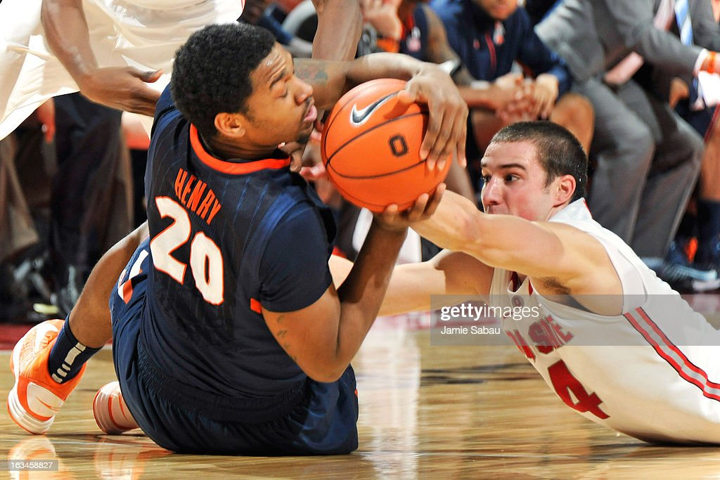 Myke Henry #20 of the Illinois Fighting Illini and <a gi-track='captionPersonalityLinkClicked' href=/galleries/search?phrase=Aaron+Craft&family=editorial&specificpeople=7348782 ng-click='$event.stopPropagation()'>Aaron Craft</a> #4 of the Ohio State Buckeyes battle to gain control of a loose ball in the second half on March 10, 2013 at Value City Arena in Columbus, Ohio. Illinois was called for a backcourt violation after gaining control and was defeated 68-55 by Ohio State.