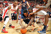Myke Henry of the Illinois Fighting Illini and Shannon Scott of the Ohio State Buckeyes dive for a loose ball in the first half as Deshaun Thomas of...