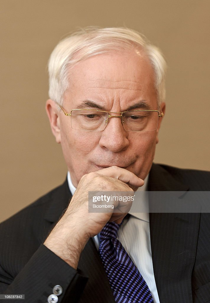 <a gi-track='captionPersonalityLinkClicked' href=/galleries/search?phrase=Mykola+Azarov&family=editorial&specificpeople=764965 ng-click='$event.stopPropagation()'>Mykola Azarov</a>, Ukraine's prime minister, pauses during an interview at the European Parliament building in Brussels, Belgium, on Wednesday, Oct. 13, 2010. Azarov said he would like to discuss a revision of the country's gas contract with Russia when he meets with Prime Minister Vladimir Putin on Oct. 27. Photographer: Jock Fistick/Bloomberg via Getty Images