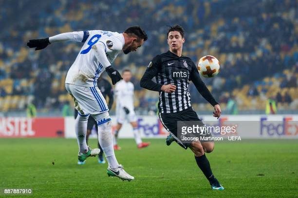 Mykola Morozyuk of FC Dynamo Kyiv heads the ball against Danilo Pantic of FK Partizan Belgrade during the UEFA Europa League group B match between FC...