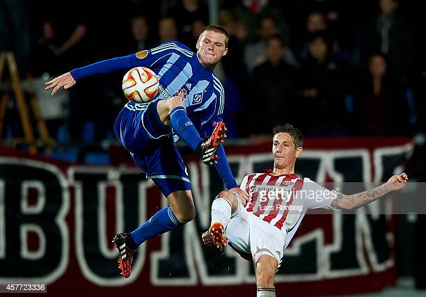Mykyta Burda of Dynamo Kyiv and Andreas Bruhn of AaB Aalborg compete for the ball during the UEFA Europa League match between AaB Aalborg and Dynamo...