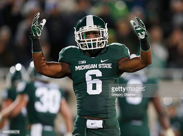 Mylan Hicks of the Michigan State Spartans pumps up the crowd prior to a secondquarter play while playing the Nebraska Cornhuskers at Spartan Stadium...