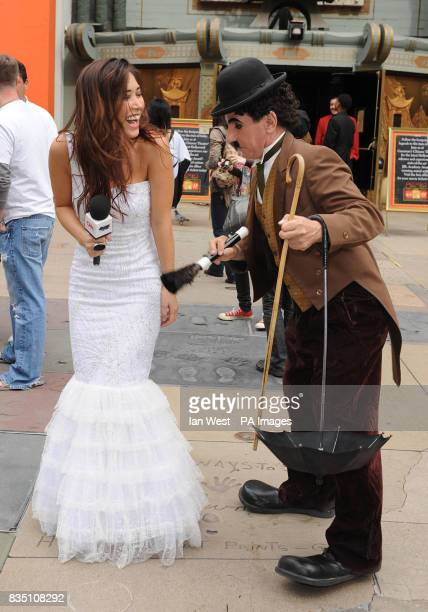 Myleene Klass tries out her interviewing techniques with a Charlie Chaplin lookalike at Grauman's Chinese Theatre in Los Angeles after she announced...