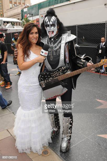 Myleene Klass tries out her interviewing techniques with a Gene Simmons lookalike at Grauman's Chinese Theatre in Los Angeles after she announced she...
