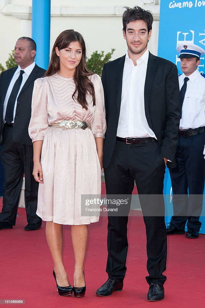 Mylene Jampanoi and friend Dimitri arrive at the closing ceremony of the 38th Deauville American Film Festival on September 8, 2012 in Deauville, France.