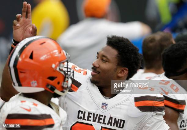 Myles Garrett of the Cleveland Browns waves to fans in the fourth quarter against the Houston Texans at NRG Stadium on October 15 2017 in Houston...