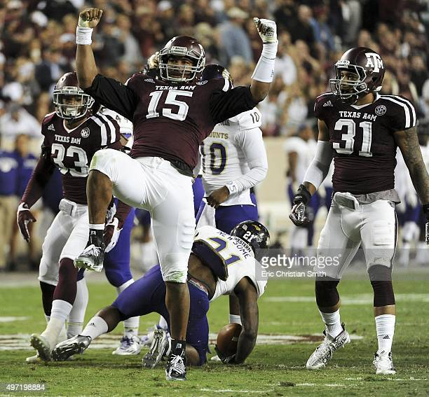 Myles Garrett of the Texas AM Aggies celebrates his tackle of Detrez Newsome of the Western Carolina Catamounts in the first quarter of a NCAA...