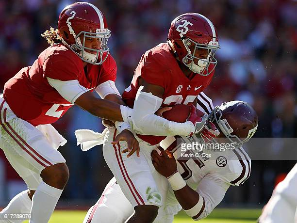 Myles Garrett of the Texas AM Aggies tackles Joshua Jacobs of the Alabama Crimson Tide as he is taking a handoff from Jalen Hurts at BryantDenny...