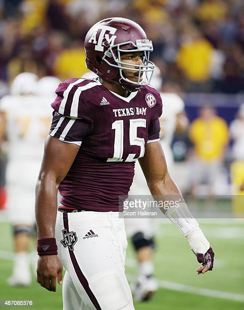 Myles Garrett of the Texas AM Aggies walks off the field in the first half of their game against the Arizona State Sun Devils during the Advocare...