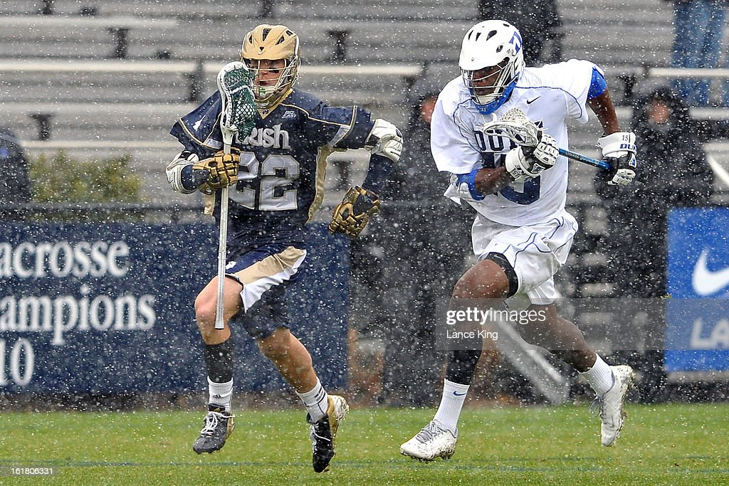 Myles Jones #15 of the Duke Blue Devils chases Jack Near #22 of the Notre Dame Fighting Irish at Koskinen Stadium on February 16, 2013 in Durham, North Carolina. Notre Dame defeated Duke 13-5.