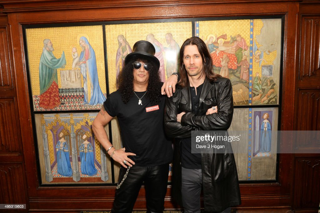 Myles Kennedy and Slash attend an album launch for Slash's new album 'World On Fire' at The Houses Of Parliament on June 2 2014 in London England