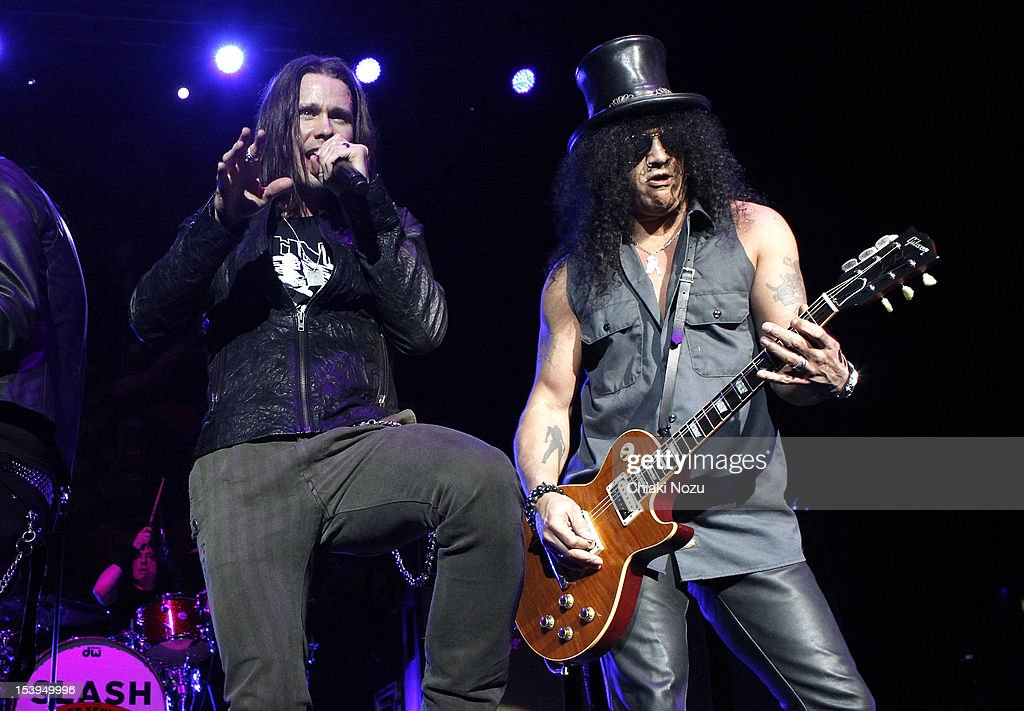 Myles Kennedy and Slash perform at Brixton Academy on October 11 2012 in London England