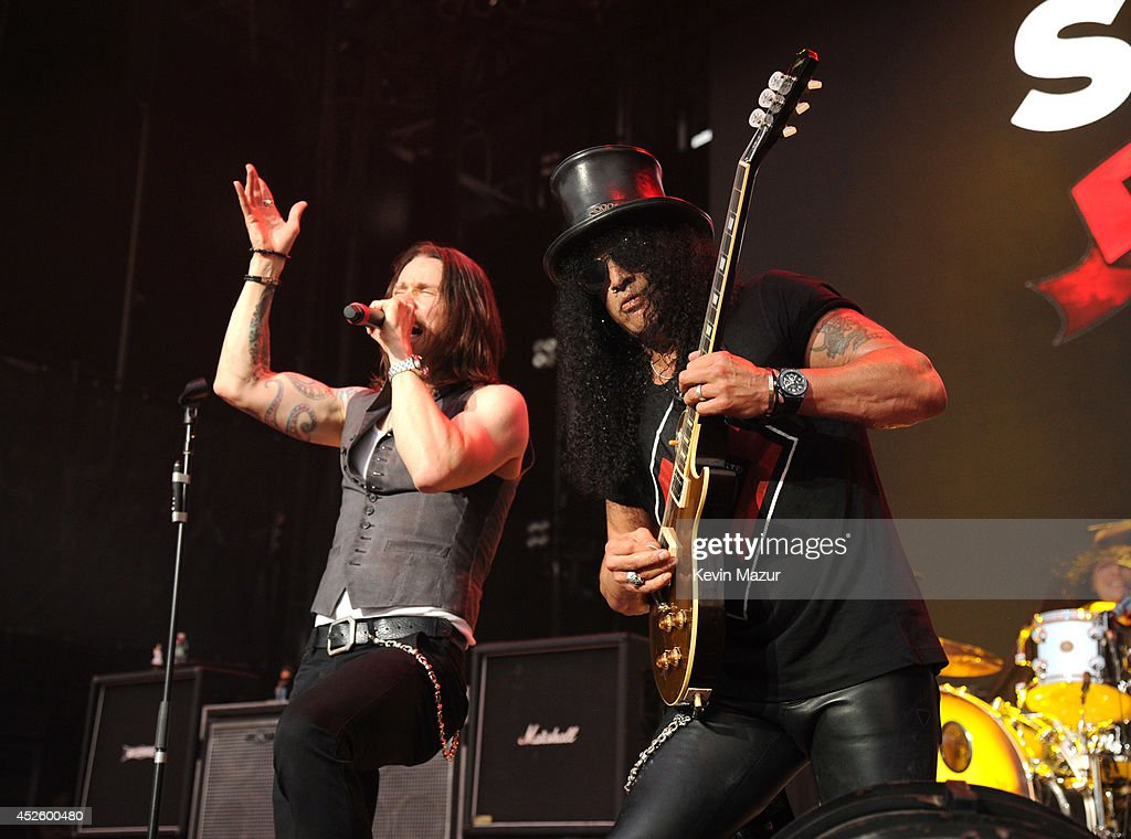 <a gi-track='captionPersonalityLinkClicked' href=/galleries/search?phrase=Myles+Kennedy&family=editorial&specificpeople=2140249 ng-click='$event.stopPropagation()'>Myles Kennedy</a> and Slash perform at Nikon at Jones Beach Theater on July 10, 2014 in Wantagh, New York.