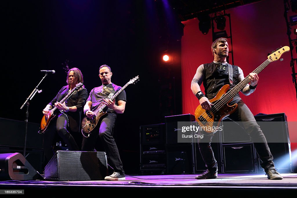 Myles Kennedy Mark Tremonti and Brian Marshall of Alter Bridge perform on stage at Wembley Arena on October 18 2013 in London England