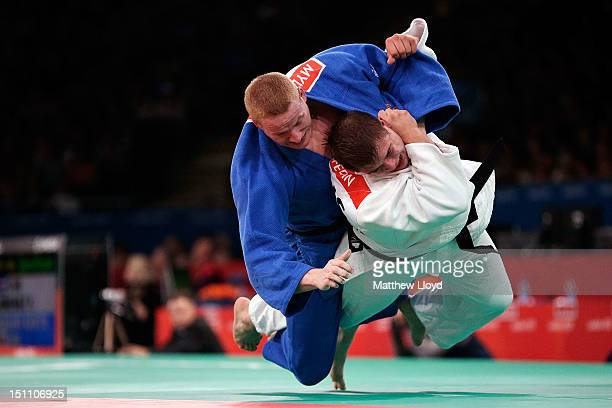 Myles Porter of the United States and Vladimir Fedin of Russia compete in the 100 kg Judo category on day 3 of the London 2012 Paralympic Games at...