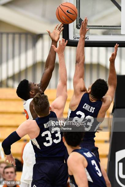 Myles Stephens of the Princeton Tigers Dalton Nixon of the Brigham Young Cougars and teammate Yoeli Childs vie for the ball during the first half at...
