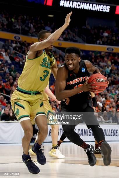 Myles Stephens of the Princeton Tigers drives to the basket against VJ Beachem of the Notre Dame Fighting Irish during the first round of the 2017...
