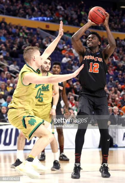 Myles Stephens of the Princeton Tigers shoots the ball against Rex Pflueger of the Notre Dame Fighting Irish during the first round of the 2017 NCAA...
