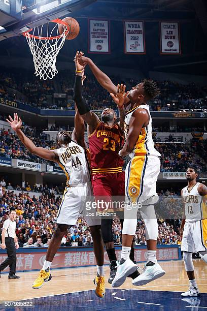 Myles Turner and Solomon Hill of the Indiana Pacers defend against LeBron James of the Cleveland Cavaliers in the second half of the game at Bankers...