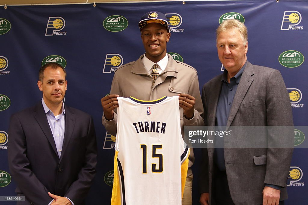 Myles Turner first round draft pick of the Indiana Pacers along Pacers head coach Frank Vogel and Pacers President Larry Bird take questions from the...