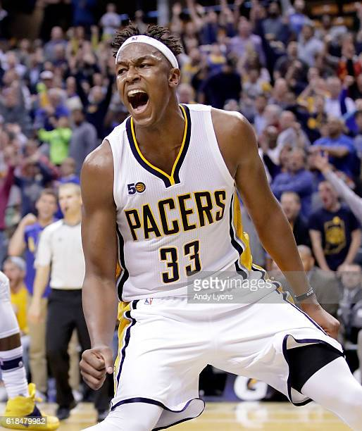 Myles Turner of the Indiana Pacers celebrates after scoring in overtime during the game against the Dallas Mavericks at Bankers Life Fieldhouse on...