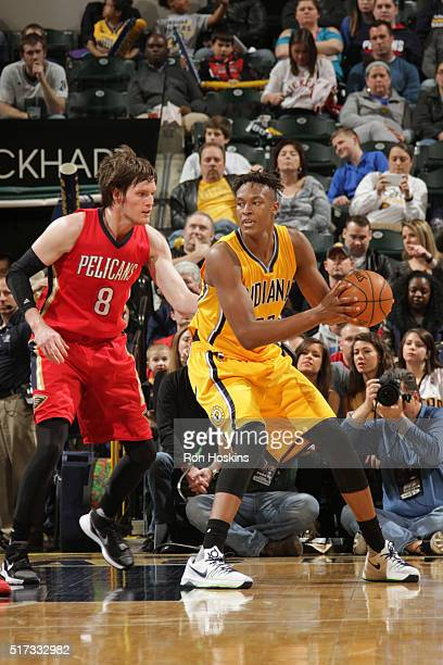 Myles Turner of the Indiana Pacers defends the ball against Luke Babbitt of the New Orleans Pelicans during the game on March 24 2016 at Bankers Life...