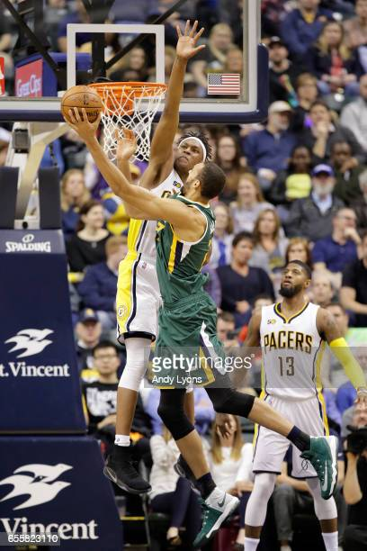 Myles Turner of the Indiana Pacers defends the shot of Rudy Gobert of the Utah Jazz at Bankers Life Fieldhouse on March 20 2017 in Indianapolis...