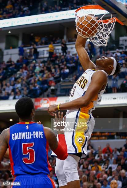 Myles Turner of the Indiana Pacers dunks the ball against Kentavious CaldwellPope of the Detroit Pistons at Bankers Life Fieldhouse on March 8 2017...