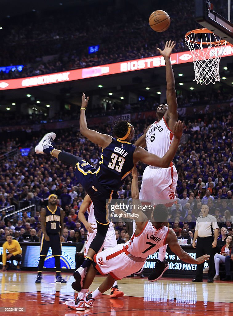 <a gi-track='captionPersonalityLinkClicked' href=/galleries/search?phrase=Myles+Turner+-+Basketball+Player&family=editorial&specificpeople=12698395 ng-click='$event.stopPropagation()'>Myles Turner</a> #33 of the Indiana Pacers fouls <a gi-track='captionPersonalityLinkClicked' href=/galleries/search?phrase=Kyle+Lowry&family=editorial&specificpeople=714625 ng-click='$event.stopPropagation()'>Kyle Lowry</a> #7 of the Toronto Raptors as <a gi-track='captionPersonalityLinkClicked' href=/galleries/search?phrase=Bismack+Biyombo&family=editorial&specificpeople=7640443 ng-click='$event.stopPropagation()'>Bismack Biyombo</a> #8 defends in the first half of Game Two of the Eastern Conference Quarterfinals during the 2016 NBA Playoffs at the Air Canada Centre on April 18, 2016 in Toronto, Ontario, Canada.