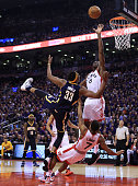 Myles Turner of the Indiana Pacers fouls Kyle Lowry of the Toronto Raptors as Bismack Biyombo defends in the first half of Game Two of the Eastern...