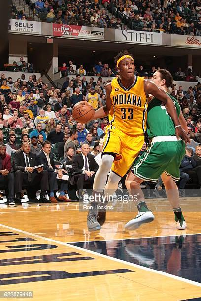 Myles Turner of the Indiana Pacers handles the ball against the Boston Celtics on November 12 2016 at Bankers Life Fieldhouse in Indianapolis Indiana...