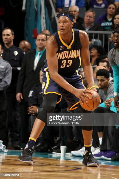Myles Turner of the Indiana Pacers handles the ball against the Charlotte Hornets on March 6 2017 at Spectrum Center in Charlotte North Carolina NOTE...