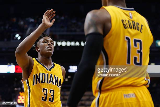 Myles Turner of the Indiana Pacers highfives Paul George after scoring against the Phoenix Suns during the second half of the NBA game at Talking...