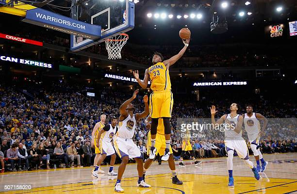 Myles Turner of the Indiana Pacers makes a rebound against the Golden State Warriors at ORACLE Arena on January 22 2016 in Oakland California NOTE TO...