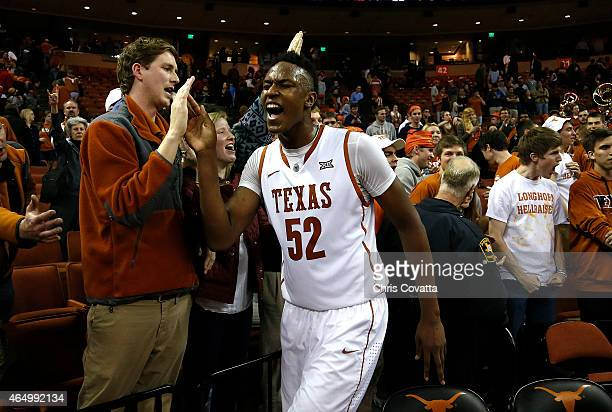 Myles Turner of the Texas Longhorns celebrates after defeating the Baylor Bears in overtime at the Frank Erwin Center on March 2 2015 in Austin Texas
