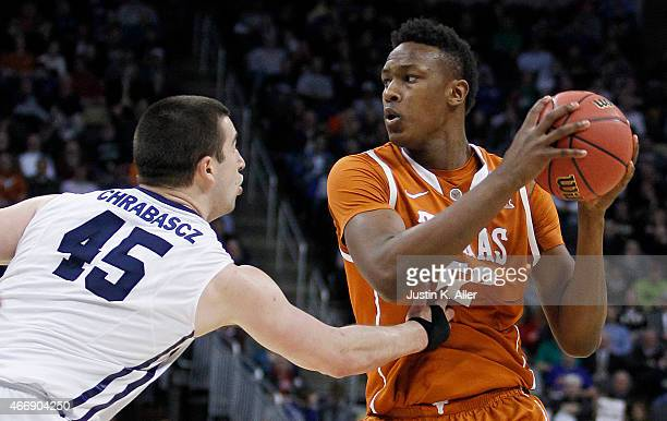 Myles Turner of the Texas Longhorns looks to pass against Andrew Chrabascz of the Butler Bulldogs in the second half during the second round of the...