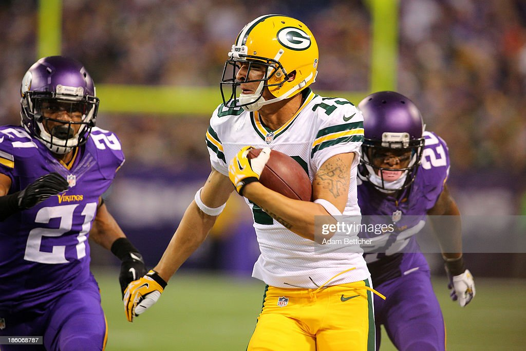 Myles White #19 of the Green Bay Packers carries the ball while Josh Robinson #21 and Chris Cook #20 of the Minnesota Vikings chase on October 27, 2013 at Mall of America Field at the Hubert Humphrey Metrodome in Minneapolis, Minnesota.