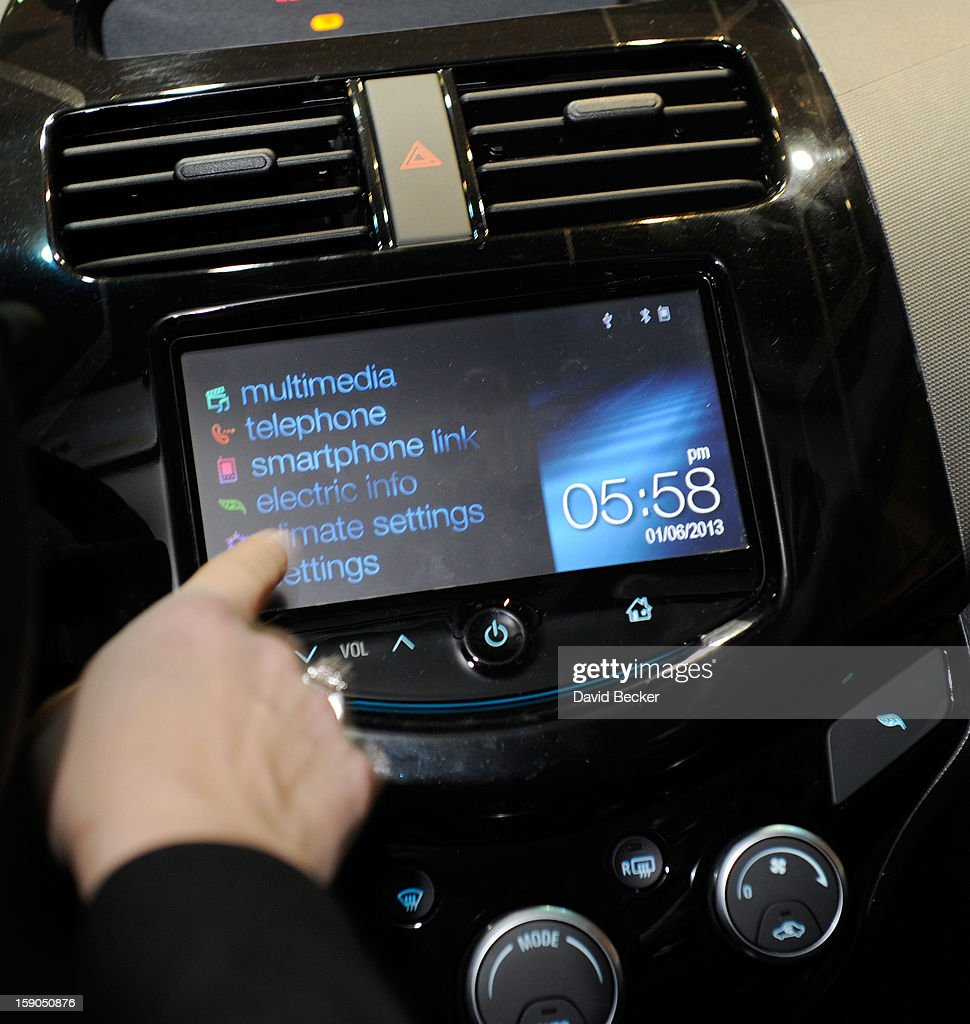 A MyLink menu is displayed inside a Chevorlet Spark electric car during a press event at the Mandalay Bay Convention Center for the 2013 International CES on January 6, 2013 in Las Vegas, Nevada. CES, the world's largest annual consumer technology trade show, runs from January 8-11 and is expected to feature 3,100 exhibitors showing off their latest products and services to about 150,000 attendees.
