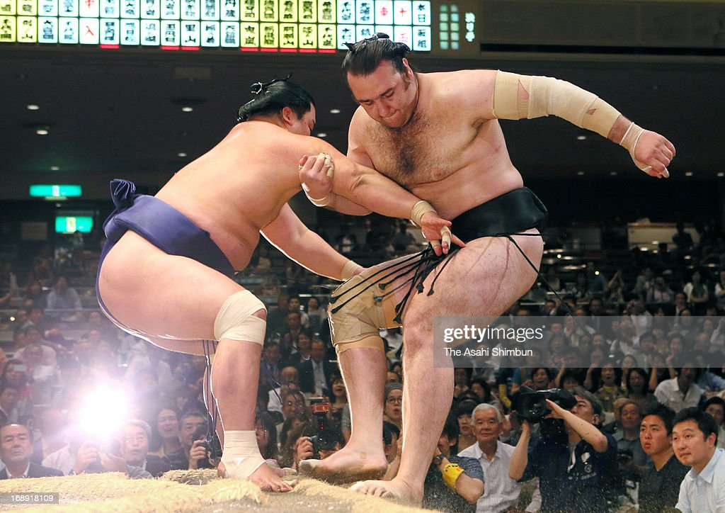 Myogiryu (L) pushes Bulgarian ozeki Kotooshu (L), whose real name is Kalojan Stefanov Mahljanov out of the ring during day five of the Grand Sumo Summer tournament at Ryogoku Kokugikan on May 16, 2013 in Tokyo, Japan.