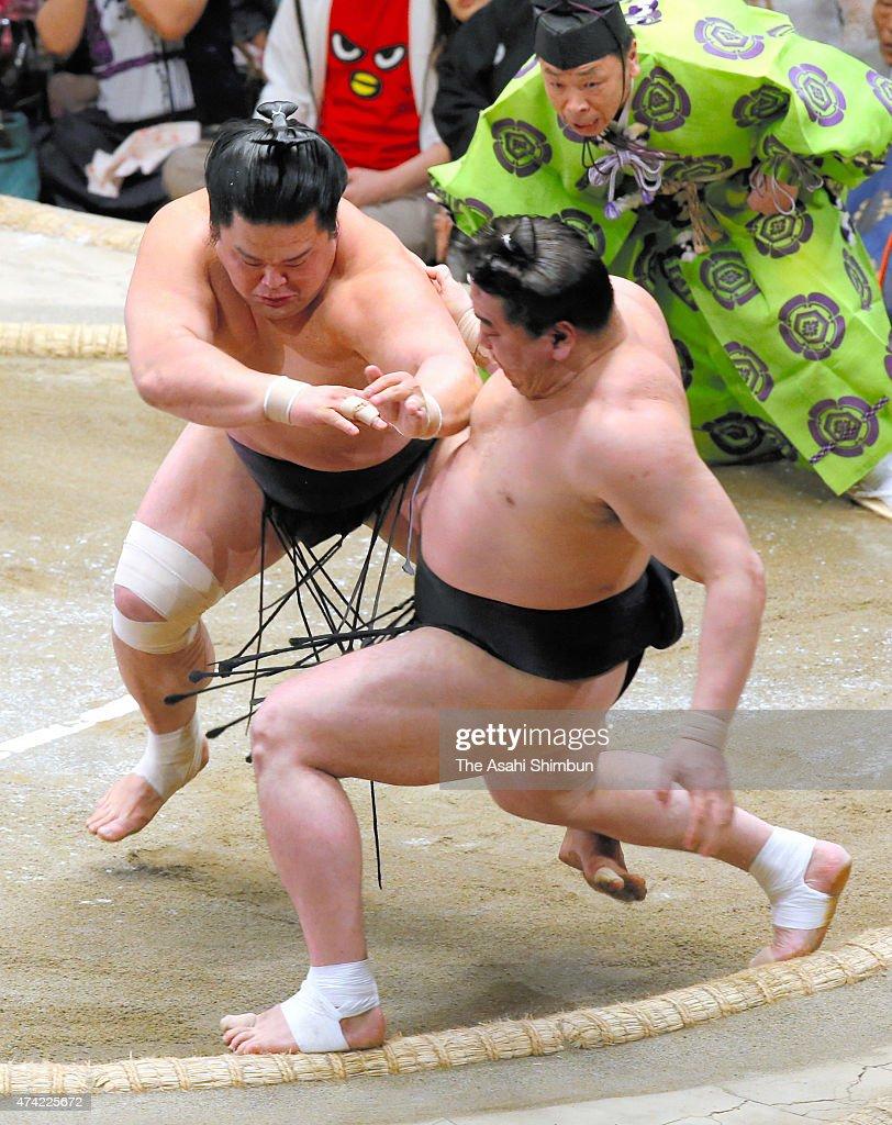 Myogiryu pushes Mongolian yokozuna Harumafuji to win during day twelve of the Grand Sumo Summer Tournament at Ryogoku Kokugikan on May 21 2015 in...