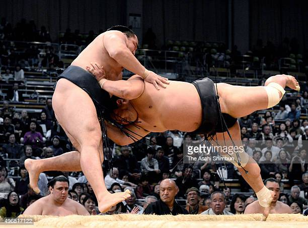 Myogiryu pushes Mongolian yokozuna Kakuryu out of the ring to win during day five of the Grand Sumo Kyushu Tournament at Fukuoka Convention Center on...