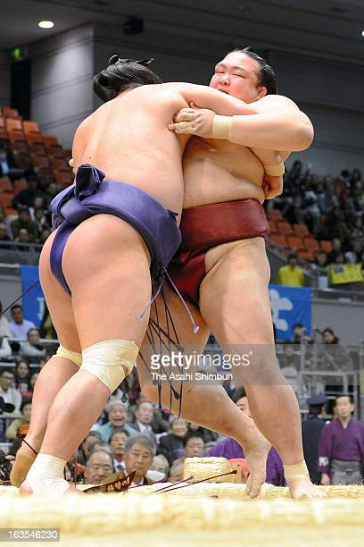 Myogiryu pushes out Kisenosato to win during day two of the Grand Sumo Spring Tournament at Osaka Prefectural Gymnasium on March 11 2013 in Osaka...