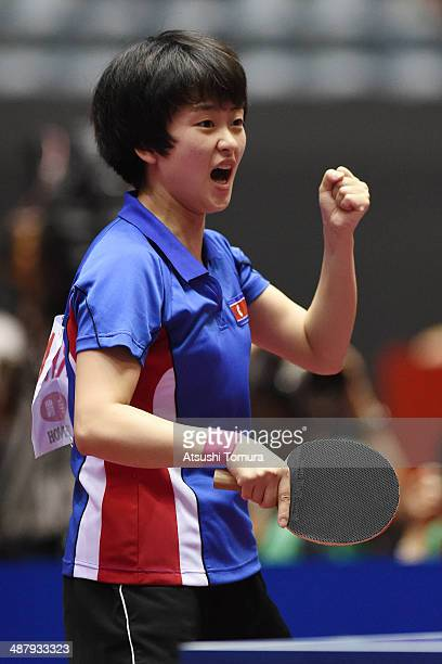 Myong Sun Ri of North Korea celebrates a point against Shiwen Liu of China during day six of the 2014 World Team Table Tennis Championships at Yoyogi...