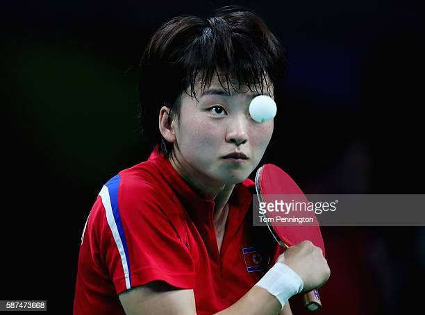 Myong Sun Ri of North Korea competes against Ai Fukuhara of Japan during Round 4 of the Women's Singles Table Tennis on Day 3 of the Rio 2016 Olympic...