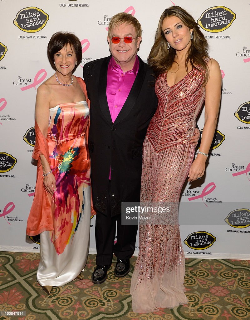 Myra Biblowit, <a gi-track='captionPersonalityLinkClicked' href=/galleries/search?phrase=Elton+John&family=editorial&specificpeople=171369 ng-click='$event.stopPropagation()'>Elton John</a> and Elizabeth Hurley attend the Breast Cancer Foundation's Hot Pink Party at the Waldorf Astoria Hotel on April 17, 2013 in New York City.