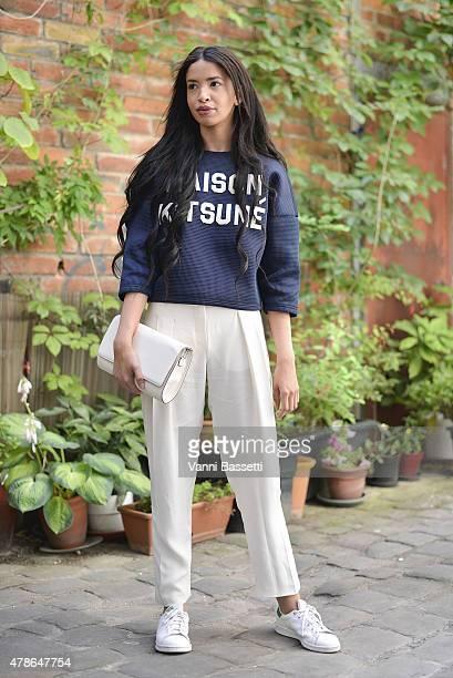 Myriam Djilali poses wearing a Maison Kitsune sweatshirt on June 26 2015 in Paris France