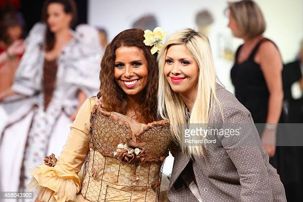 Myriam Seurat walks the runway with pastry chef Elodie Martins during the Fashion Chocolate show at Salon du Chocolat at Parc des Expositions Porte...