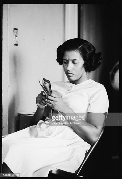 Myrlie Evers looks at a memento after her husband Medgar's assassination
