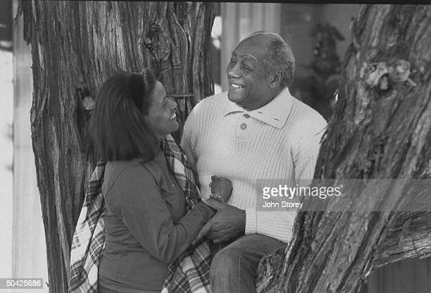 Myrlie Evers widow of slain civil rights leader Medgar Evers posing against a tree w her husband civil rights activist Walter Williams during their...
