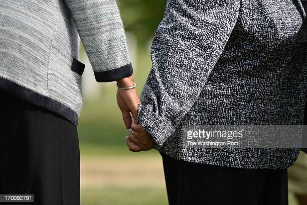 Myrlie EversWilliams and her daughter Reena Denise EversEverette briefly hold hands during a private ceremony at the gravesite of Medgar Wiley Evers...